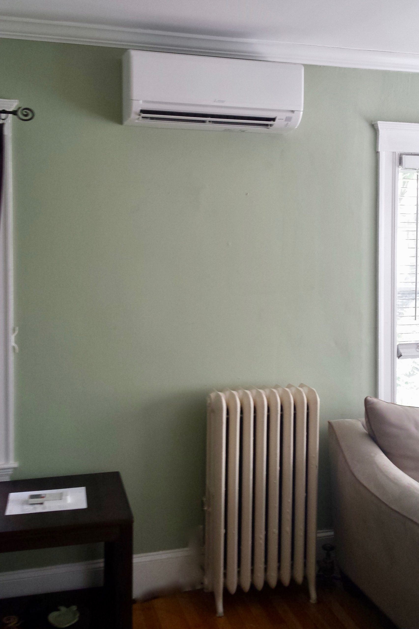 Ductless HVAC hanging wall unit in Dorchester, MA condo