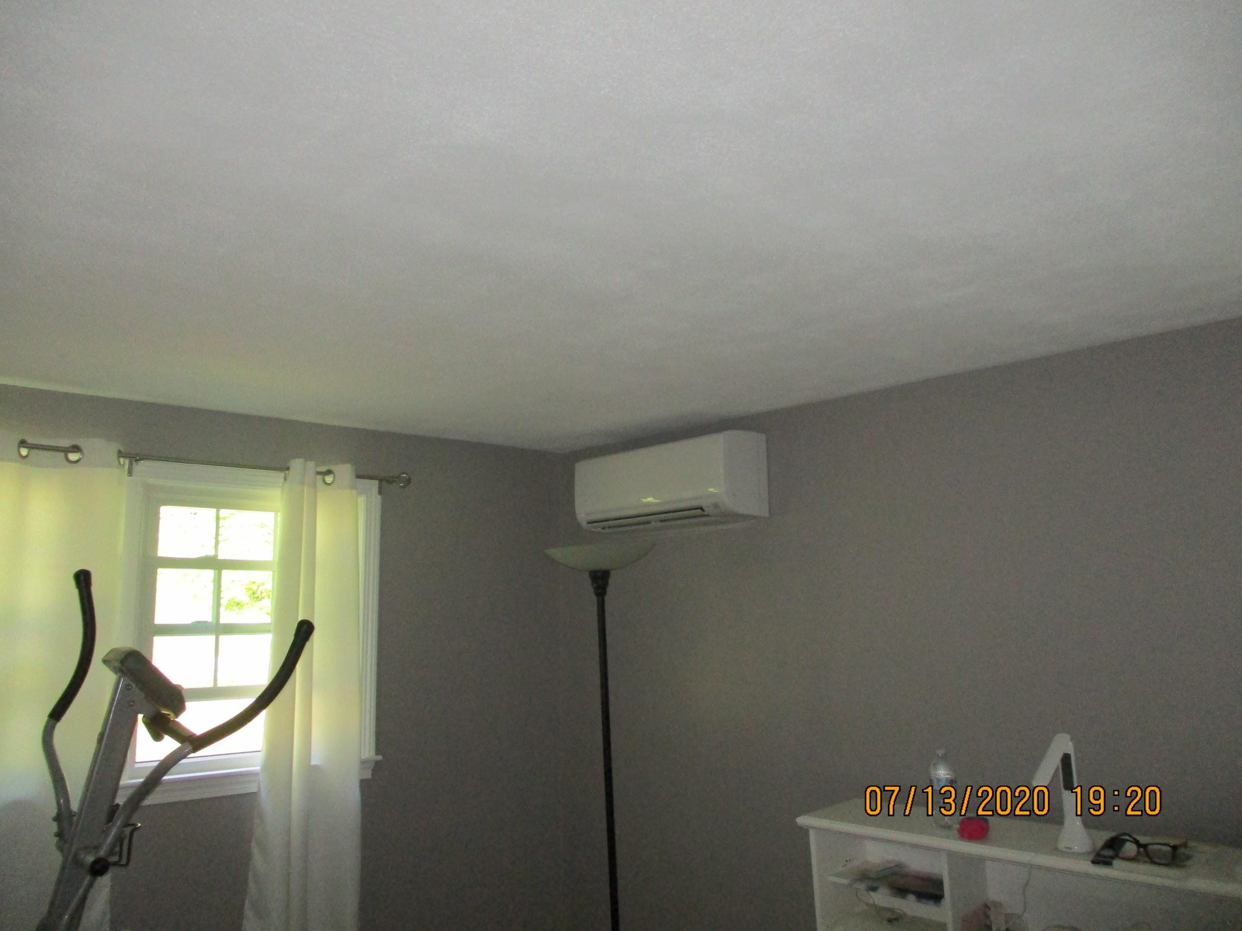 Ductless AC installed in Framingham, MA, split-level home.