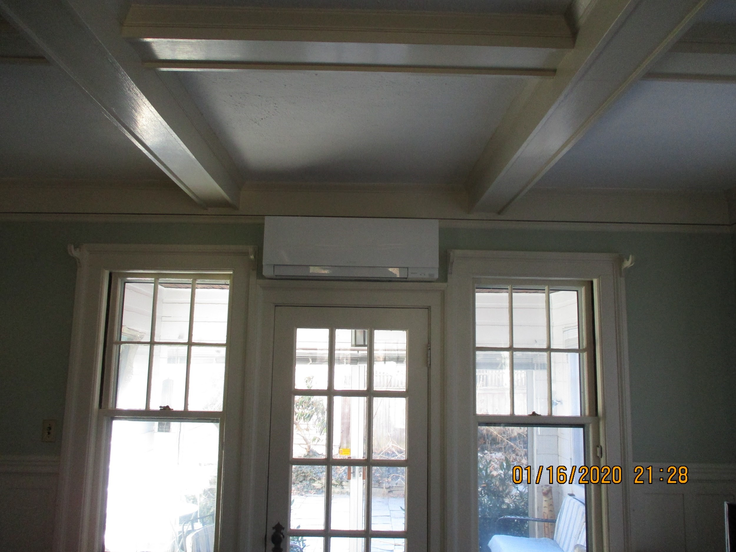 Ductless AC mounted above the doorway in Winchester, MA.