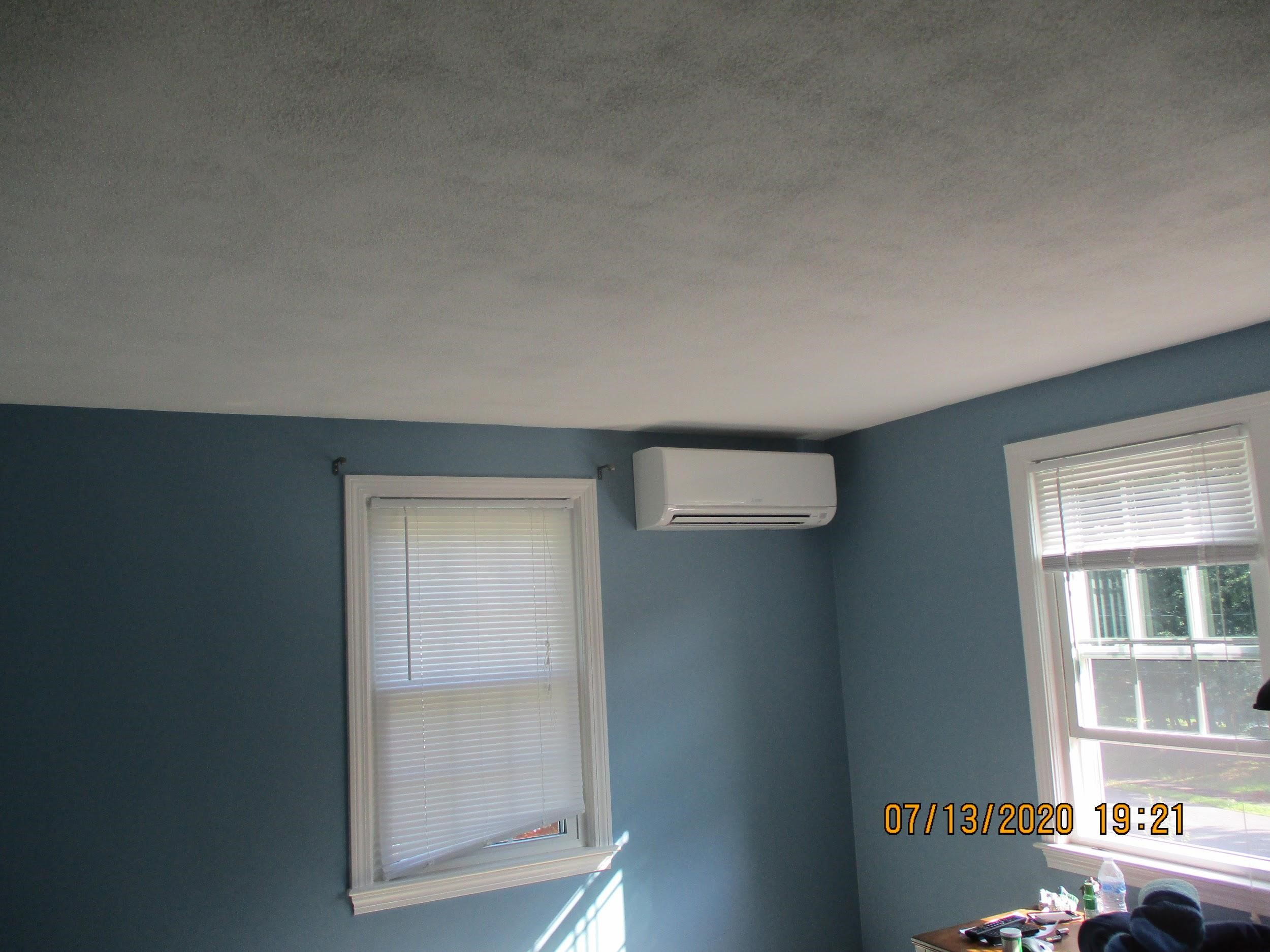 Example of an indoor ductless AC for new Mitsubishi system in Framingham, MA, split-level home.