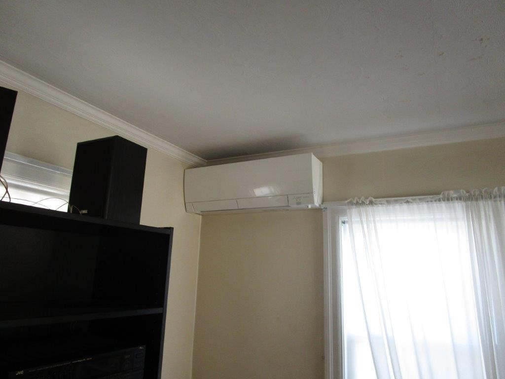 Example of an indoor ductless AC in a Brighton, MA, home.