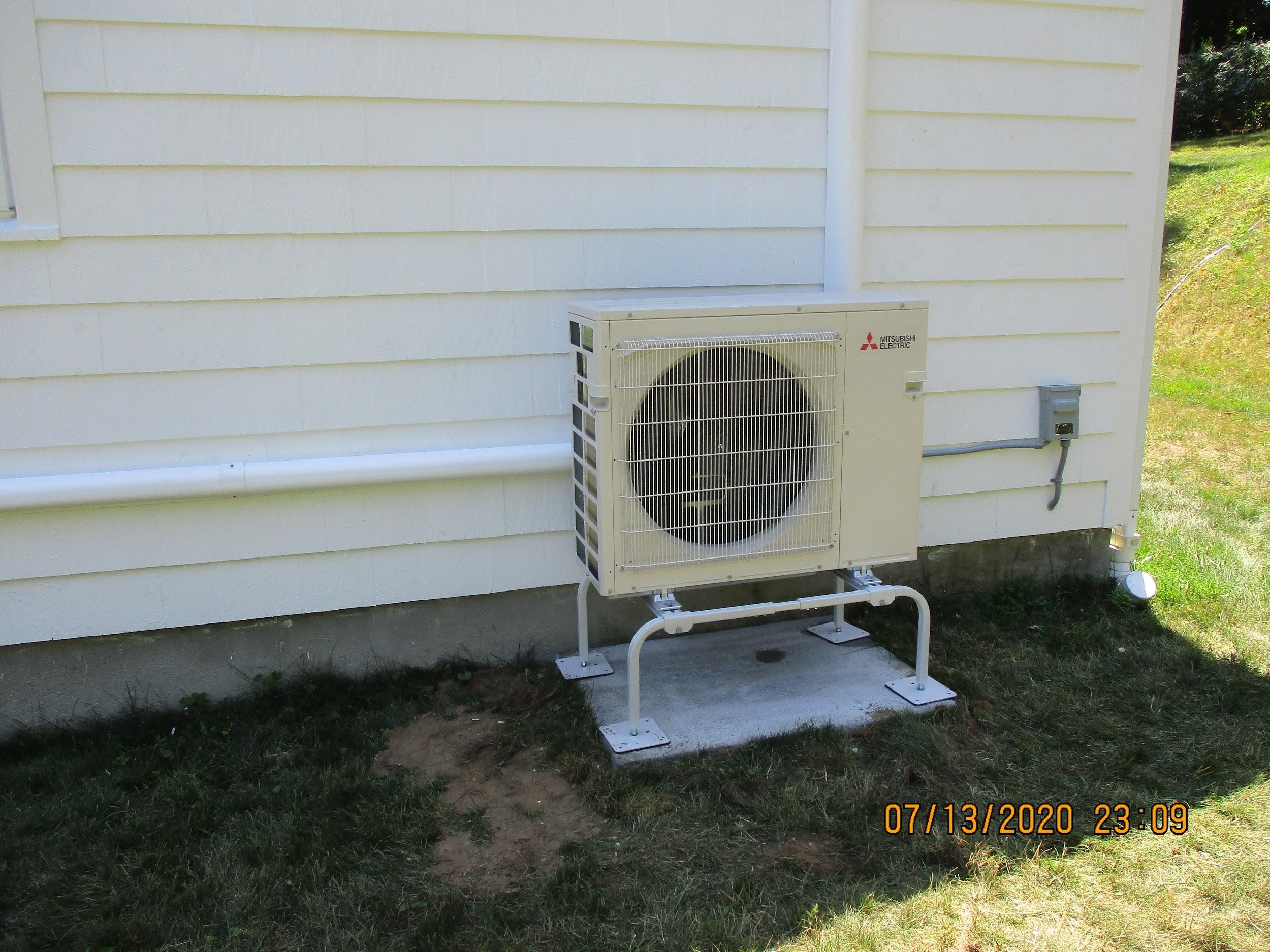 Example of an outdoor condenser unit installed in Framingham, MA, home for Mitsubishi ductless system.