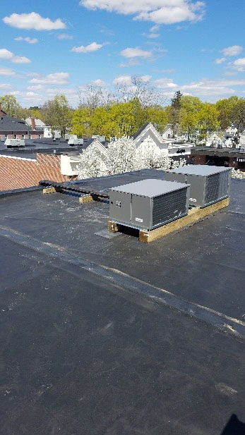 Industrial freezer compression unit installed on rooftop in Andover, MA.