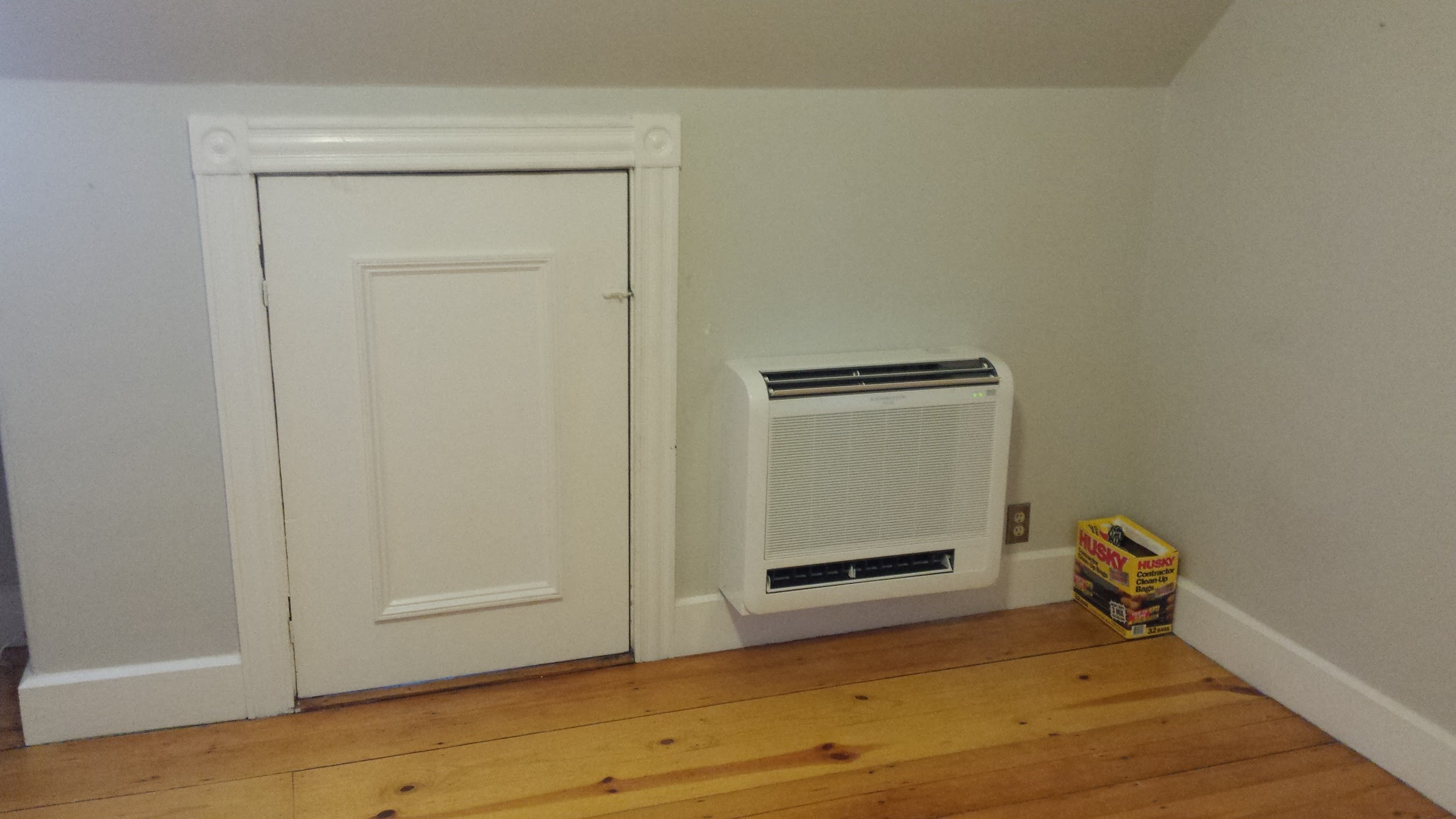 Mitsubishi ductless floor AC installed in Jamaica Plain Victorian home.