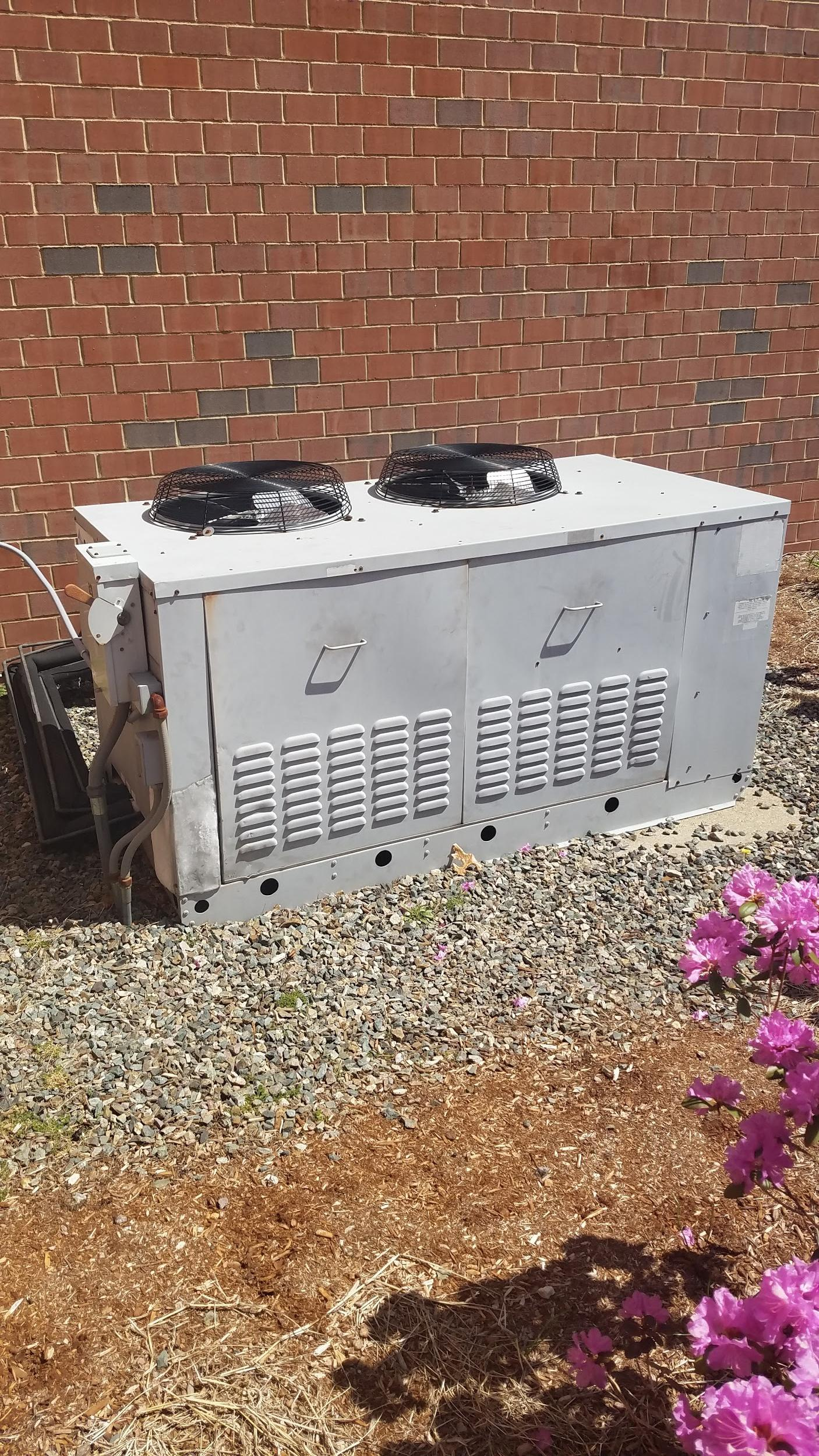 New outdoor condenser unit installed for walk-in refrigeration system in Westwood, MA.