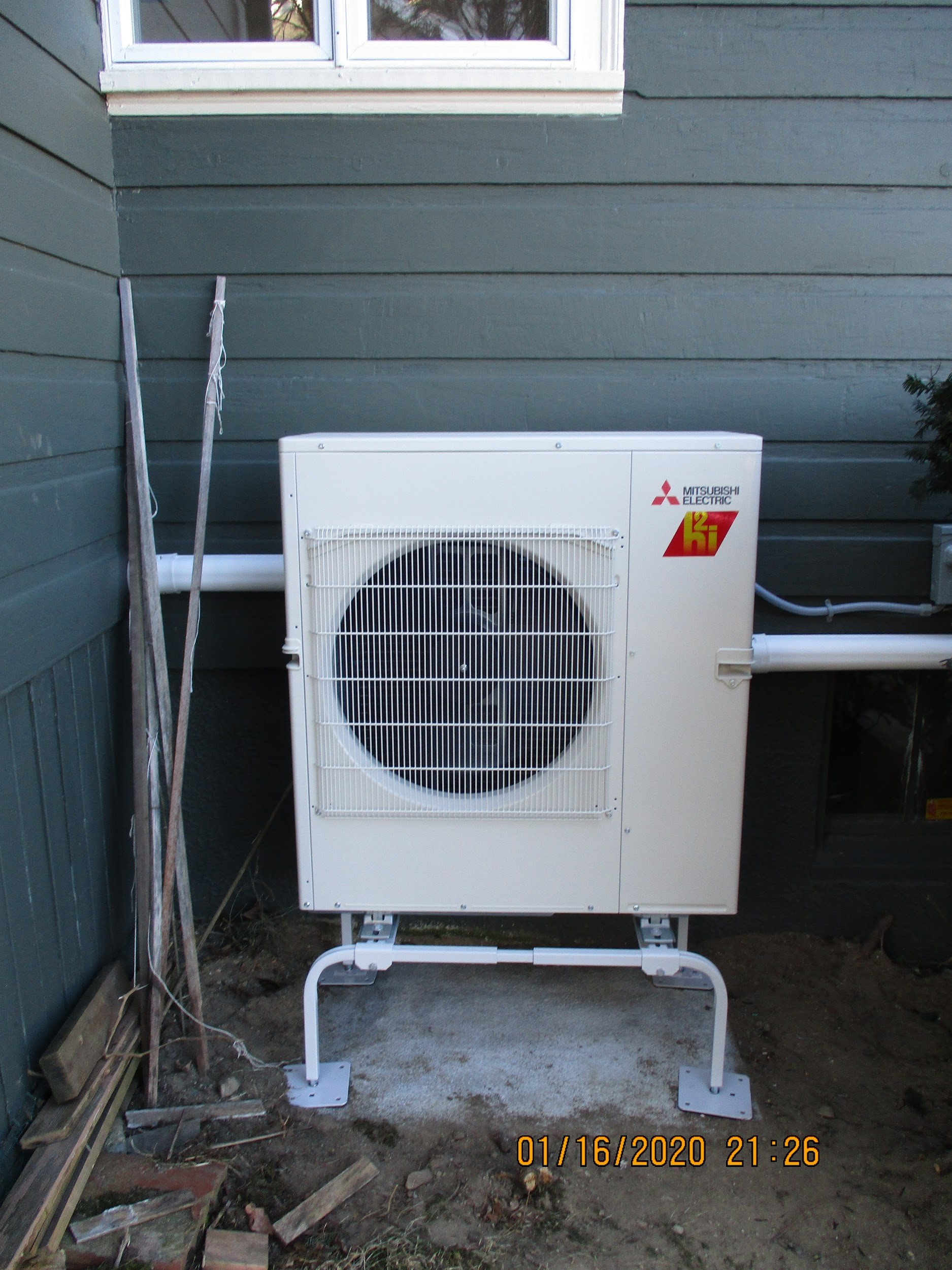 Outdoor AC and heat pump condenser installed in MA.