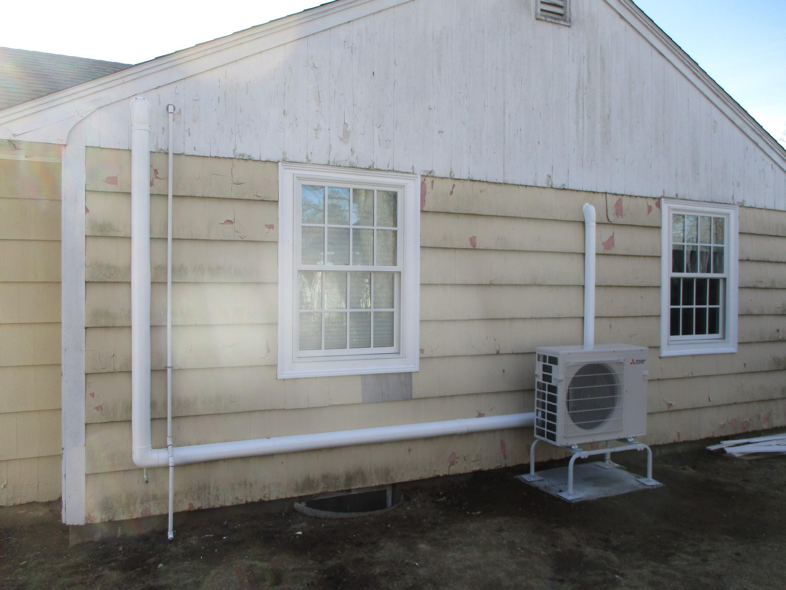 Outdoor condenser and heat pump installed for Mitsubishi ductless system in Hamilton, MA.