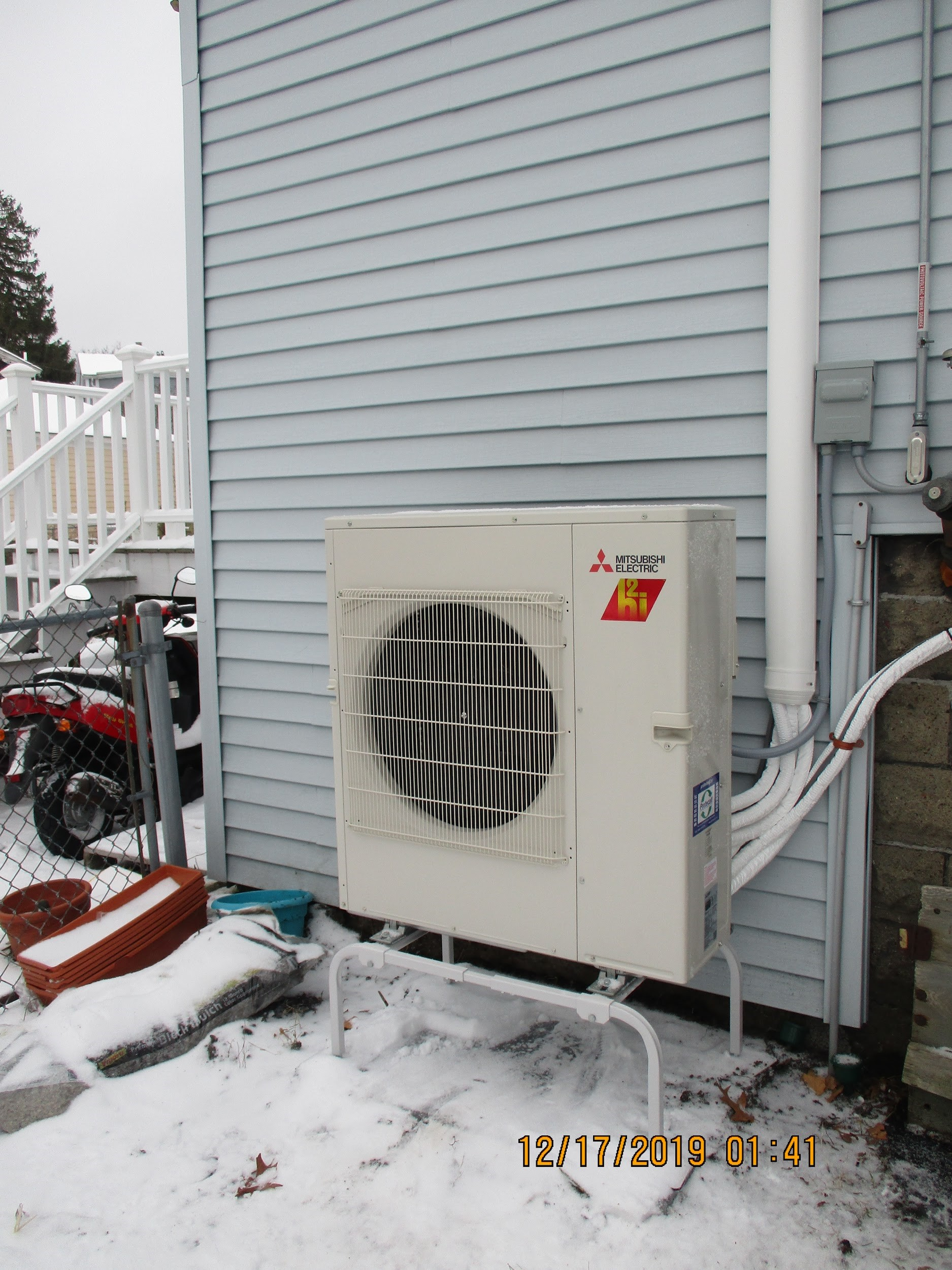 Outdoor condenser installed for Salem home ductless AC system.