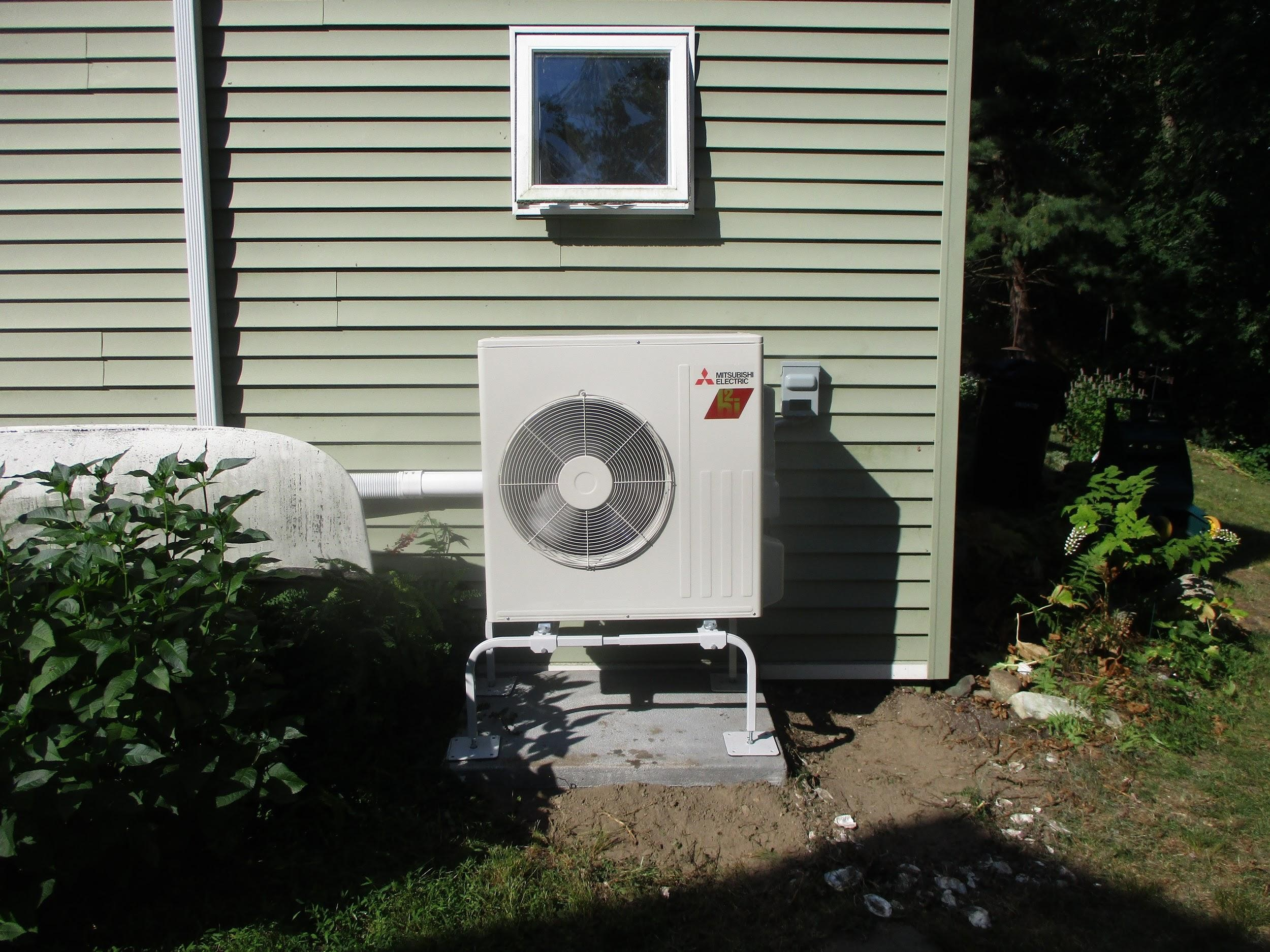 Outdoor heat pump installed for Mitsubishi system in Framingham home.