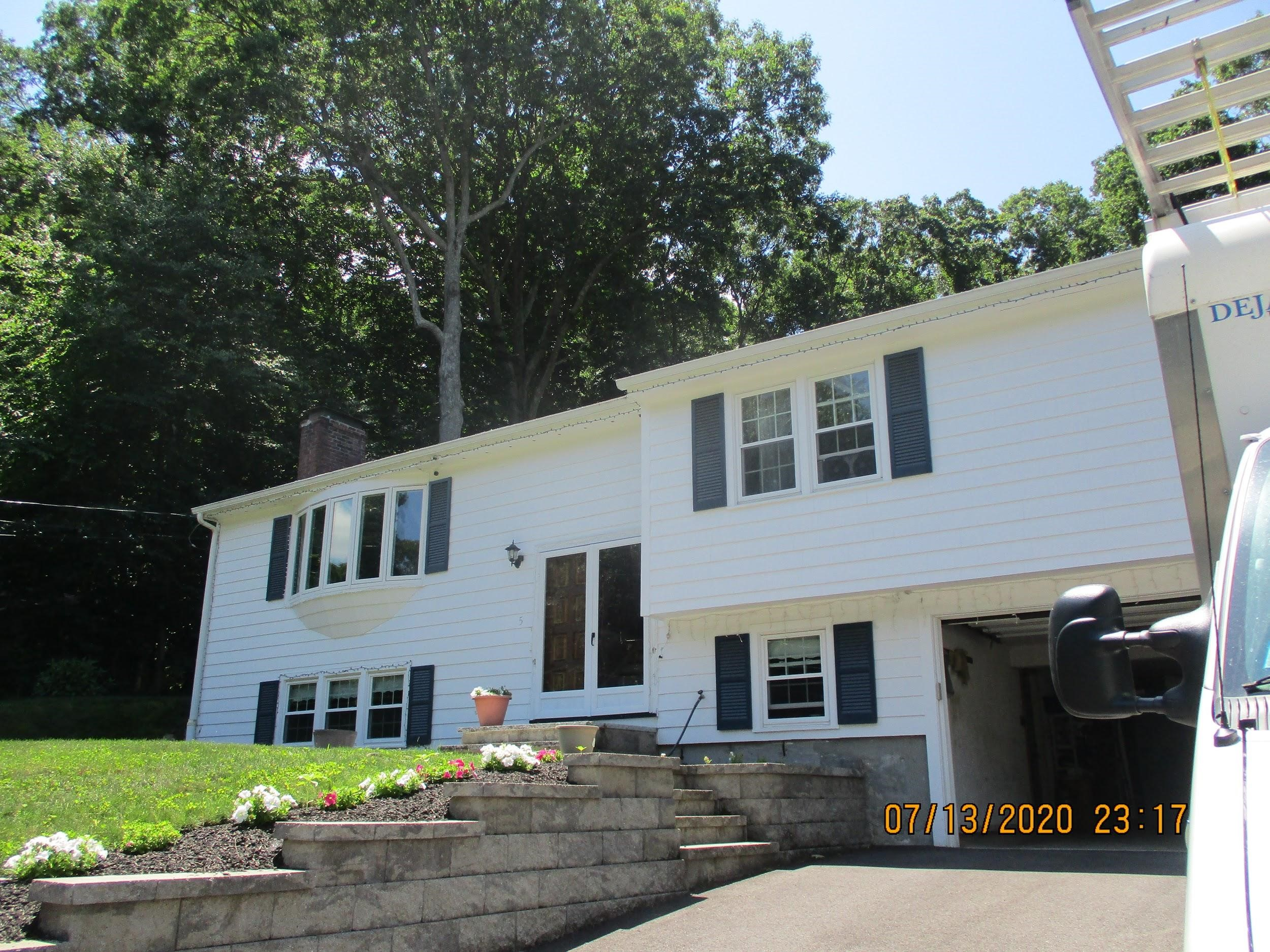 Split-level home in Framingham upgrades to Mitsubishi ductless AC system.