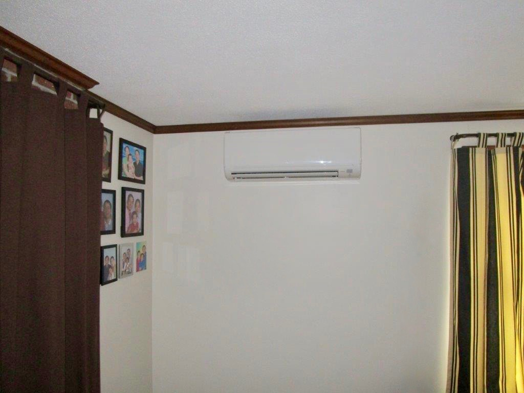 Indoor installation of wall unit for ductless heating and air.