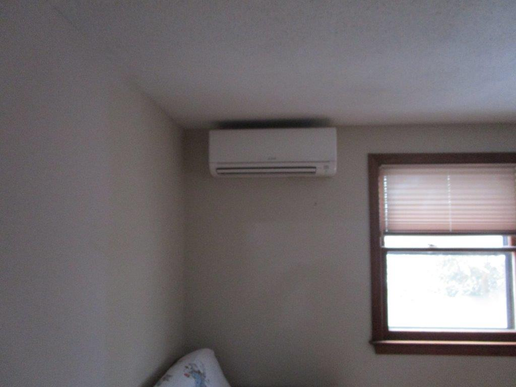 Wall unit ductless installation in kid's bedroom.