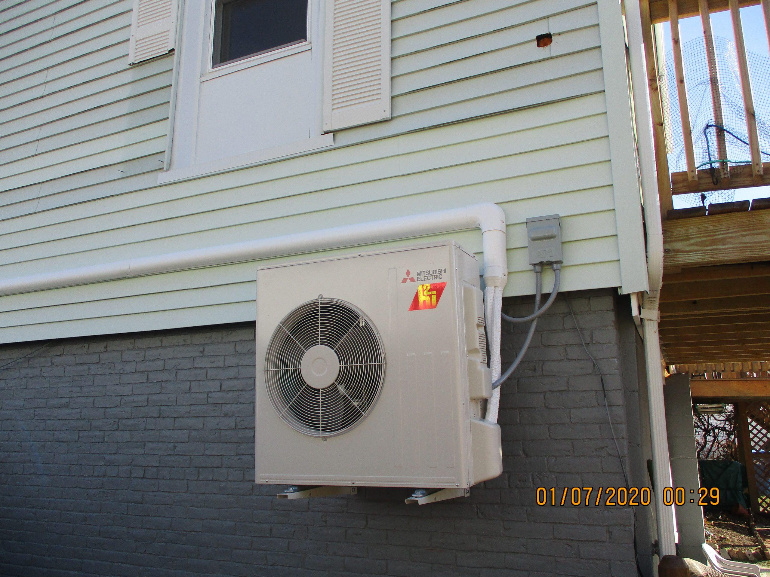 Outdoor condenser unit installed in Somerville, MA.