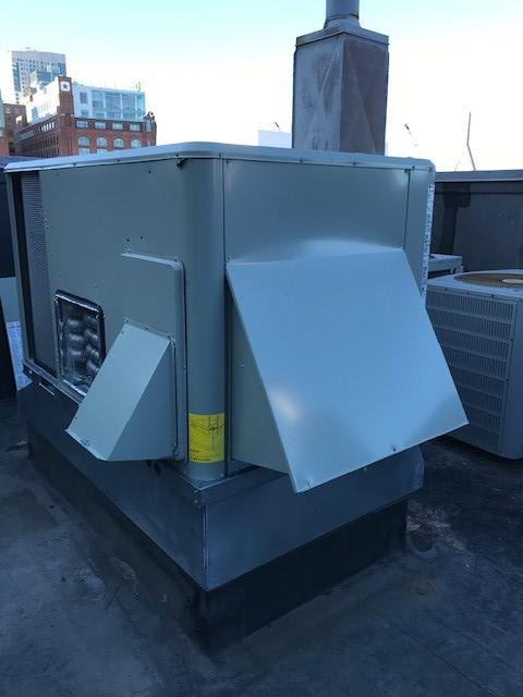 Boston, MA, funeral home gets replacement heating unit installed on the roof.