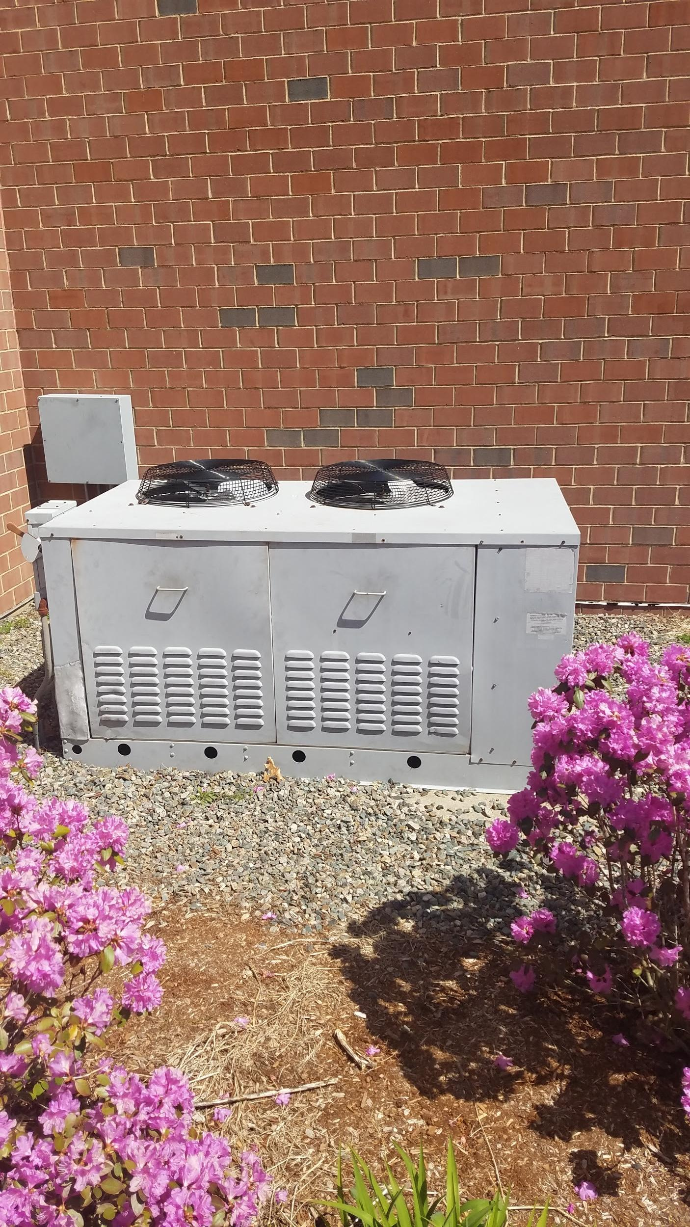 Westwood High School gets an outdoor condenser unit upgraded for cafeteria walk-in cooler system.