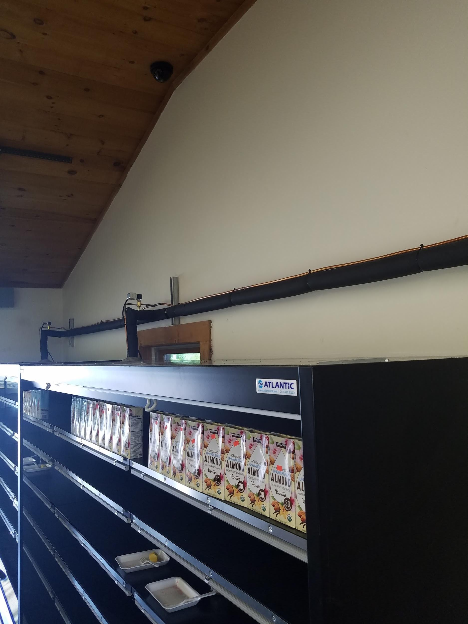 Example of properly installed condensate piping installed in MA grocery store.