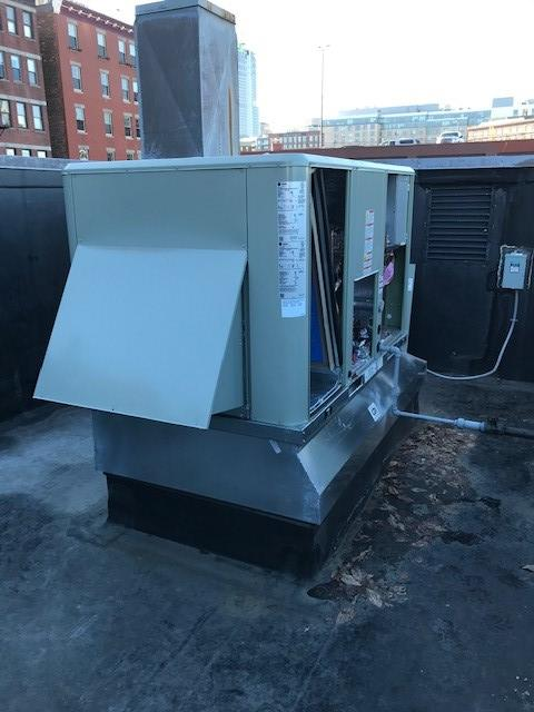 Outdoor condenser unit for American Standard HVAC system in Boston.