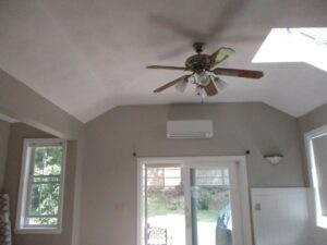 Example of an indoor Mitsubishi ductless AC unit installed in a home in Marblehead, MA, for heating and cooling.