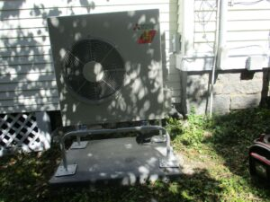 Mitsubishi ductless outdoor condenser unit installed outside Swampscott, MA, home.
