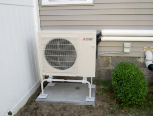A Mitsubishi Electric ductless AC system outdoor condenser unit installed for ductless AC system in Winthrop.