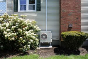 Example of an outdoor air condenser installed in a split-level home in Beverly, MA, for a Mitsubishi ductless air conditioning system.