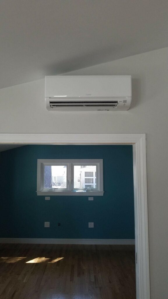 New air handler installed inside the an Arlington, MA, home for Mitsubishi ductless AC system upgrade.