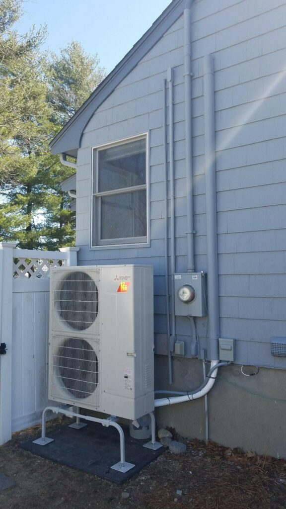 Example of an outdoor condenser unit installed outside a ranch home in Arlington for Mitsubishi Electric AC system.