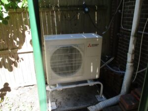 Outdoor condenser and heat pump installed for Mitsubishi Electric ductless heating and AC system in Boston.