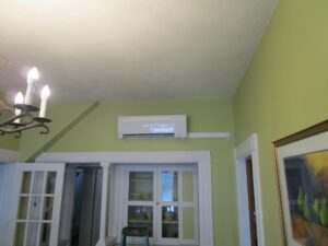 Example of an indoor Mitsubishi ductless air handler installed in Boston two-family home.